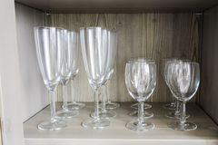 Collection of wine glasses. On a wooden shelf Stock Photography