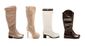 Collection of winter and autumn boots. Isolated on white background Royalty Free Stock Photo