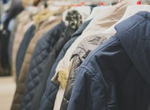 Collection of winter jackets. Collection of winter jackets in clothing store Stock Photos