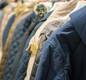 Collection of winter jackets. Collection of winter jackets in clothing store Royalty Free Stock Images