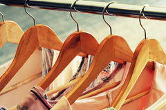 Collection of women`s clothes hanging on rack Royalty Free Stock Photos