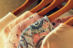 Collection of women`s clothes hanging on rack Stock Image
