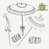 Collection womens old umbrellas. Vector illustration sketch on paper background Royalty Free Stock Images