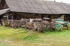 Collection of wooden carts in the Belarusian estate. Belarus, Na royalty free stock images
