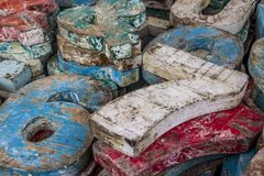 Shabby paint on surface of vintage wooden accessories with numbers and letters. Stock Image