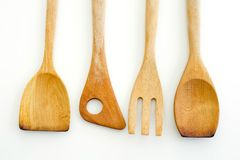 A collection of wooden kitchen utensils isolated on white backgr Royalty Free Stock Photos