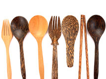 A collection of wooden kitchen utensils isolated on white background. A collection of wooden kitchen utensils isolated on white royalty free stock photo
