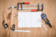 Collection of worktools, set of working tools. (Steel wrench, hammer, nails, bolts, wrenches, etc.) with notebook on the wooden ta Royalty Free Stock Image