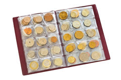 Collection of world money coins in album Stock Image