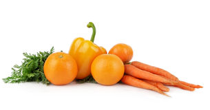 Collection of yellow, orange vegetables and fruits on white Royalty Free Stock Photo