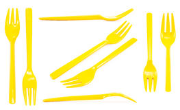 Collection yellow plastic forks isolated on white background Royalty Free Stock Image