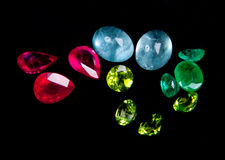 Collections of gems. Isolated on black background. Gemstone Stock Images