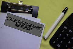 Collective Bargaining Agreement text on Document form isolated on office desk.