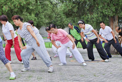 Collective early morning exercise in a park, Beijing, China Stock Photo