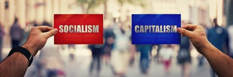 Collectivisme versus kapitalisme stock fotografie