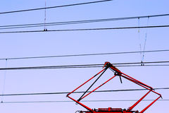Collector electric wire. The composition with the current collector and lines in the sky Stock Photo