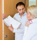 Collector getting the arrears from woman Royalty Free Stock Photos