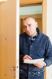 Collector  trying to get  arrears. Businessman trying to collect money  at home door Stock Image
