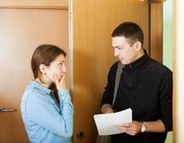 Collector is trying to get the arrears. From woman Royalty Free Stock Image