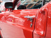 Collectors meeting of classic cars and muscle cars. Door handle detail. Royalty Free Stock Photos