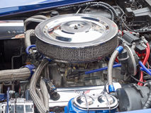 Collectors meeting of classic cars and muscle cars. Engine with big air filter. Stock Photos