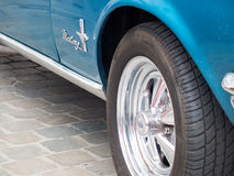 Collectors meeting of classic cars and muscle cars. Mustang chromed wheel. Royalty Free Stock Images
