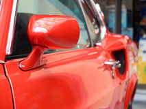 Collectors meeting of classic cars and muscle cars. Rearview mirror. Royalty Free Stock Images