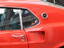 Collectors meeting of classic cars and muscle cars. Side of a Mustang. Stock Image