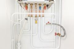 Collegamento del riscaldamento e dell'acqua calda immagine stock