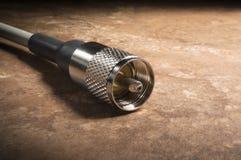 Collegamento dell'antenna radiofonica del prosciutto al cavo coassiale Immagine Stock