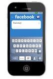 Collegamento di Facebook sul iphone della mela Fotografia Stock Libera da Diritti