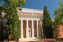 College administrative building. A view of a college administrative building with columns and trees at the main entrance Stock Photos