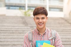 College asian male student holding book in campus Royalty Free Stock Photography