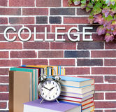 College book. Education concept with book and college word on wall Royalty Free Stock Photos