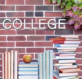 College book. Education concept with book and college word on wall Royalty Free Stock Photo