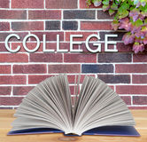 College book. Education concept with book and college word on wall Stock Photography