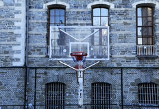 College building and basketball hoop Stock Photography