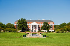 College campus library. A view across an open grass lawn to the entrance of a university campus building on a bright and sunny morning.  University of Maryland Royalty Free Stock Photos