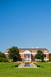 College campus library. A view across an open grass lawn to the entrance of a university campus building on a bright and sunny morning.  University of Maryland Stock Photography