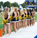 College Cheerleaders. Waiting for their team to come onto the field Royalty Free Stock Photo