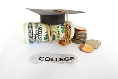 College costs. Graduation mortar board on cash with College paper scrap Stock Photo