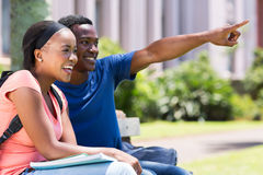 College couple pointing Stock Photos