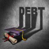 College Debt. And student financial concept as a graduation mortar board and diploma with a cast shadow as an icon for tuition loan repayment or lending and Royalty Free Stock Image