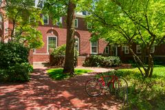 College dormitory. Red brick college dormitory with a bicycle and trees stock image