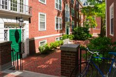 College dormitory. Red brick college dormitory with a bicycle and trees stock images