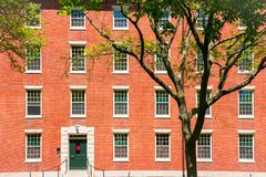 College dormitory. Red brick college dormitory with trees stock photography