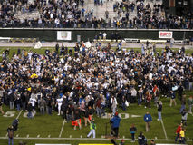 College football celebratetion on the field after end a game Royalty Free Stock Photo