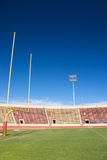 College football Field. Stands and goal posts in College football stadium Royalty Free Stock Images