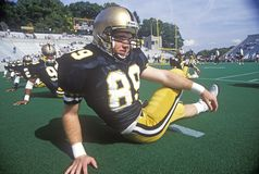 College football player doing pre-game stretch at the  Army vs. Lafayette game, Michie Stadium, New York Royalty Free Stock Photography