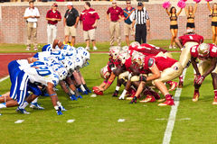 College Football. Tallahassee, FL - Oct. 27, 2012:  Florida State Seminole offense squares off against Duke University's defense at a college football game on Royalty Free Stock Images